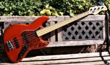 Pristine 1st Generation Sire Marcus Miller V7 Fretless 4-String J-Type Bass Guitar, Bright Metallic Red, With Sire Padded Gig Bag